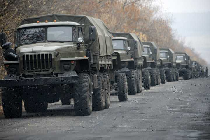 Unmarked military vehicles parked on a road outside the separatist rebel-held eastern Ukrainian town of Snizhne, 80 kilometers (50 miles) from Donetsk on Saturday Nov. 8, 2014. AP reporters saw more than 80 military vehicles on the move Saturday in separatist-controlled areas, indicating intensified hostilities may lie ahead. (AP Photo/Mstyslav Chernov)